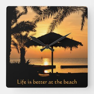 Personalized wall clock featuring a sunset at a tropical beach